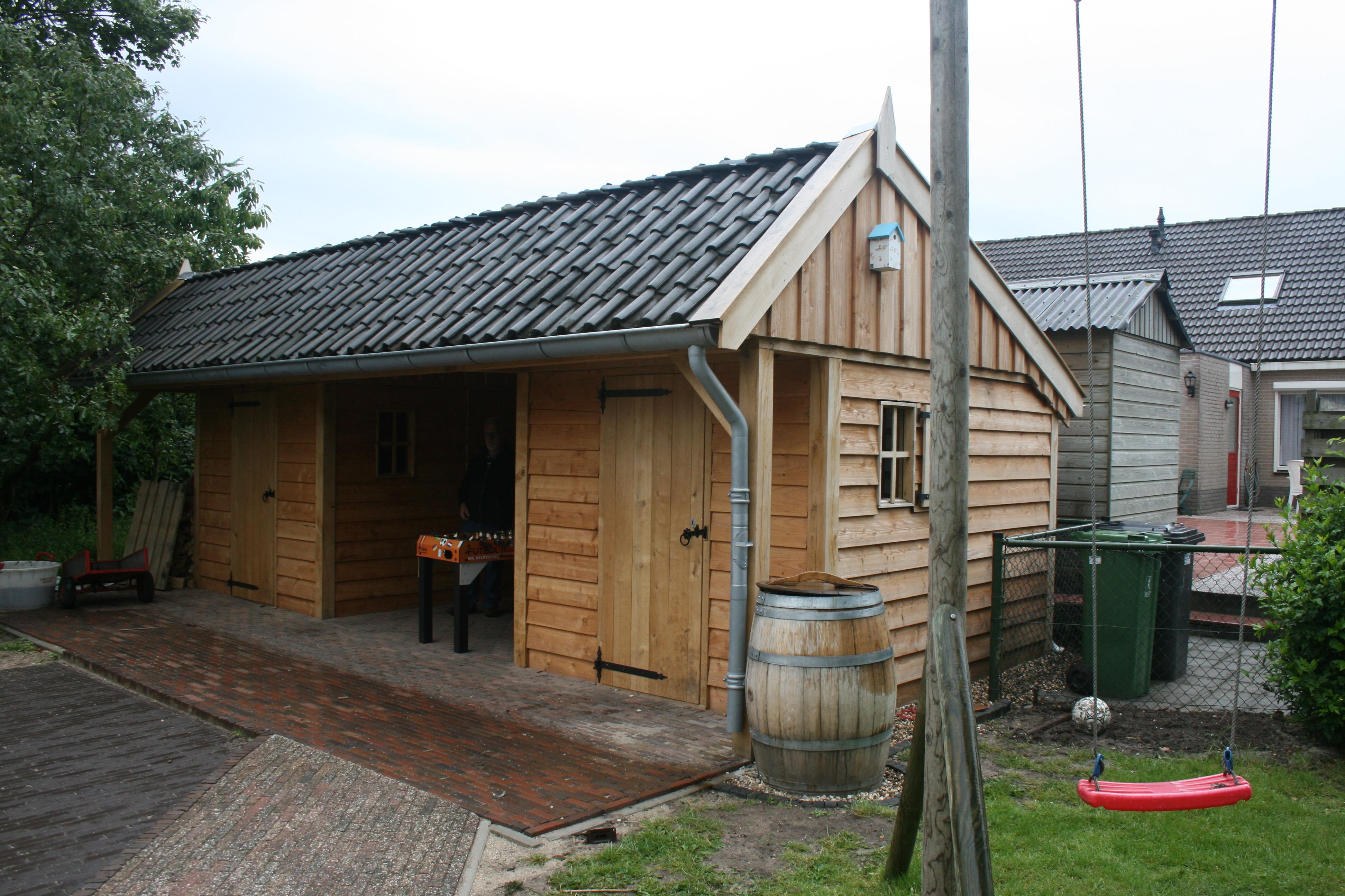 houten kapschuur met tuinkamer