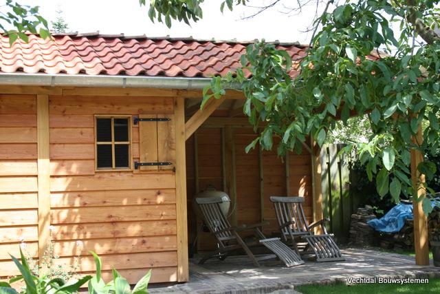 Exclusieve_tuinhuizen - Luxe eikenhouten tuinhuis met luifel op maat gemaakt.