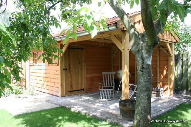 exclusieve_tuinhuis - Luxe eikenhouten tuinhuis met luifel op maat gemaakt.
