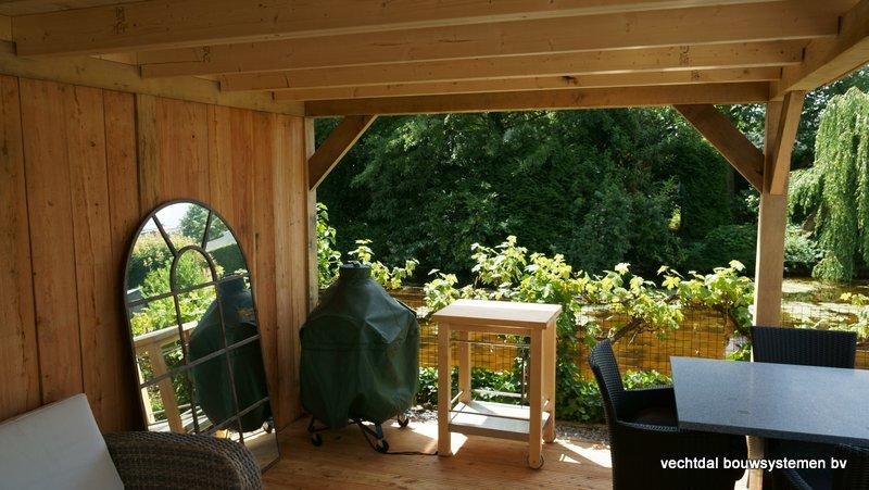 eikenhouten_tuinhuis_met_platdak_Rottedam_(5) - Geniet optimaal van de warme zomeravonden in een sfeervolle eikenhouten tuinkamer.