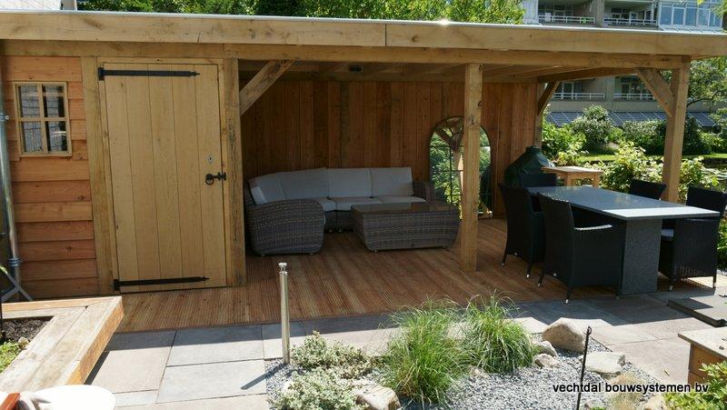 eikenhouten_tuinhuis_met_platdak_Rottedam_(7) - Geniet optimaal van de warme zomeravonden in een sfeervolle eikenhouten tuinkamer.