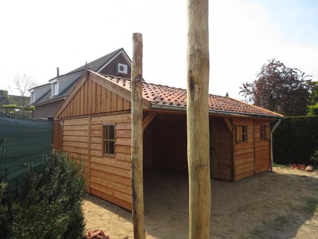 eiken_houten_tuinhuis - Luxe eikenhouten tuinhuis met veranda gemonteerd in Limburg.