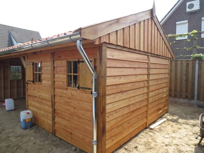 eiken_houten_tuinhuis_14 - Luxe eikenhouten tuinhuis met veranda gemonteerd in Limburg.