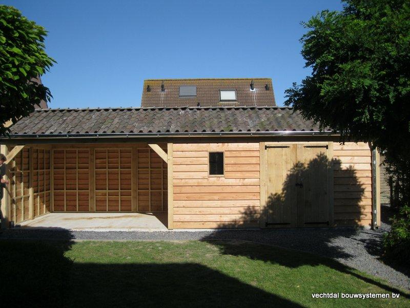 houten_tuinhuis_met_veranda_breskens_(1) - Stijlvolle eikenhouten tuinhuis met veranda geplaatst in Breskens (Zeeland).