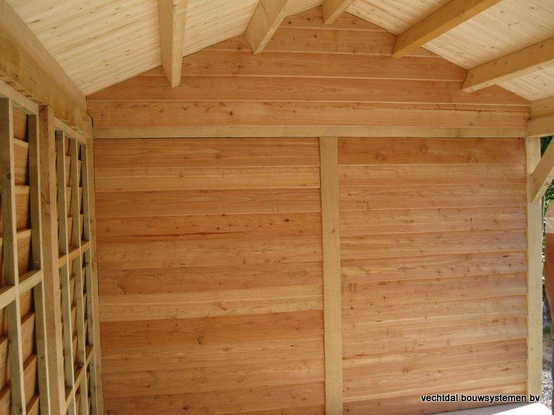 houten_tuinhuis_met_veranda_breskens_(15) - Stijlvolle eikenhouten tuinhuis met veranda geplaatst in Breskens (Zeeland).