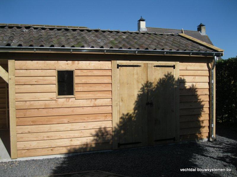 houten_tuinhuis_met_veranda_breskens_(3) - Stijlvolle eikenhouten tuinhuis met veranda geplaatst in Breskens (Zeeland).
