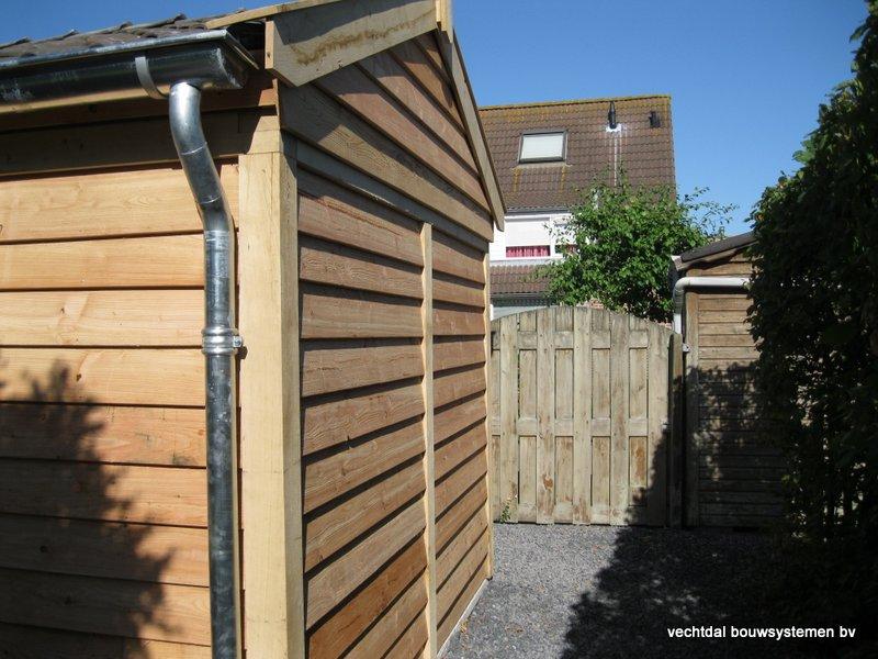 houten_tuinhuis_met_veranda_breskens_(5) - Stijlvolle eikenhouten tuinhuis met veranda geplaatst in Breskens (Zeeland).