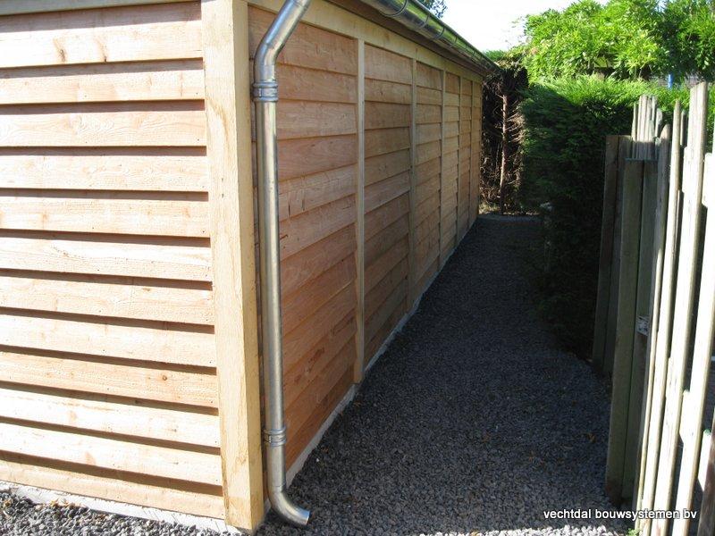 houten_tuinhuis_met_veranda_breskens_(7) - Stijlvolle eikenhouten tuinhuis met veranda geplaatst in Breskens (Zeeland).