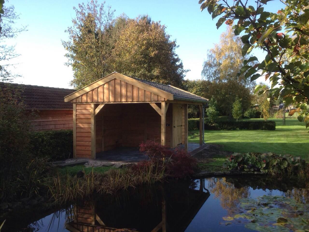 eikenhouten_tuinhuis_met_veranda - Ontdek de charme en stijlvolle uitstraling van een eikenhouten bijgebouw in de natuur.