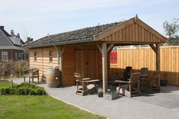 Luxe-houten-tuinhuis-met-overkapping-1-600x399 - Luxe eikenhouten tuinhuis met overkapping