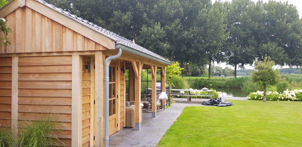 Houten-tuinhuis-met-veranda-1024x497 - Houten Tuinhuis met veranda