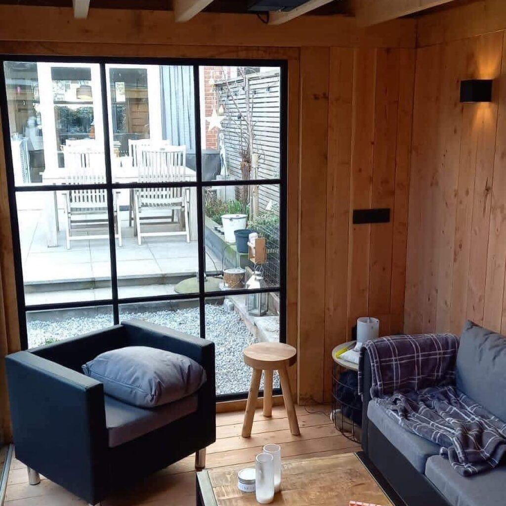 Hoekmodel-terrasoverkapping-5-1024x1024 - Stijlvolle garage met tuinkamer.